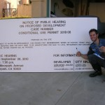 Captain with Finished Notice of Public Hearing Sign