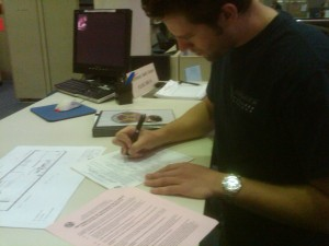 Chris Signing Form