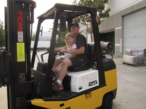 dale and daughter operating fork lift