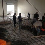 pouring cement for sloped floor drain in brewery